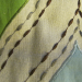 Fabric of the Month - Feb 2012 - Detail of woven fabric with emboridery & appliqued embellishment