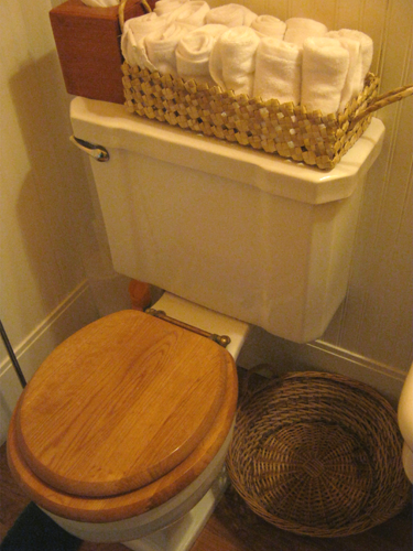 Place an empty basket on the floor by the sink for the used wash clothes
